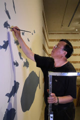 Artist Guan Wei during the installation of his show at the MCA.