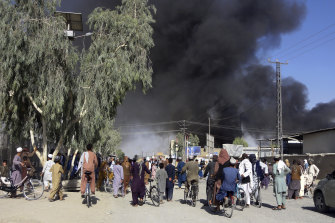Smoke rises after fighting between the Taliban and Afghan security personnel, in Kandahar, southwest of Kabul.