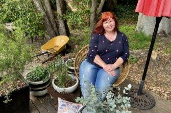 Amanda De George in her garden in Thirroul, NSW.