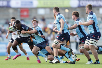 Tevita Kuridrani of the Brumbies is tackled by NSW playmaker Will Harrison during round seven of Super Rugby, just before the season was suspended.