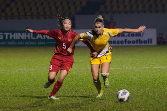 Australia's Steph Catley challenges Huynh Nhu for the ball during the qualifier.