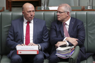 Prime Minister Scott Morrison, right, says he is not aware of anything to show Peter Dutton broke the rules of a grants program that directed money overwhelmingly to coalition or marginal electorates ahead of the 2019 election.