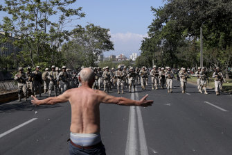A man challenges soldiers during clashes in Santiago, Chile.