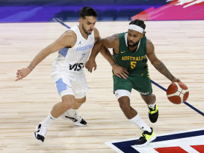 Patty Mills takes on Argentina's Facundo Campazzo.