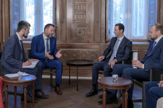 Russian-backed Syrian President Bashar al-Assad, second right, meets with Russian comrades in Damascus in August.