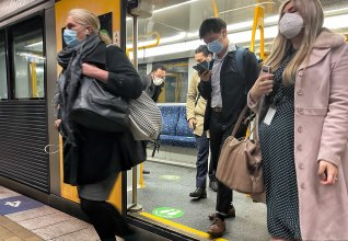 Commuters wore masks at Martin Place Station on Monday morning.