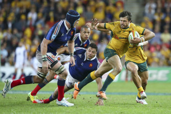 Australian right wing Adam Ashley-Cooper, right, fends off French flanker Bernard le Roux during France's last trip to Australia in 2014.