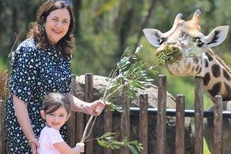 Premier Annastacia Palaszczuk, with her four-year-old niece Emma feeding a giraffe at Australia Zoo on Saturday.