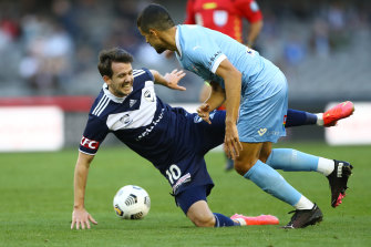 Victory's Robbie Kruse is challenged during the loss to City.