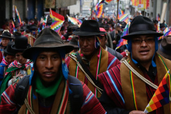 Supporters of ousted president Evo Morales take to the streets wearing traditional ponchos and waving Wiphala flags, a symbol used by the area's indigenous peoples.