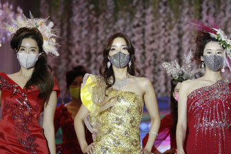 Models wearing face masks during a fashion show amid the coronavirus pandemic in Seoul, South Korea, on Friday.