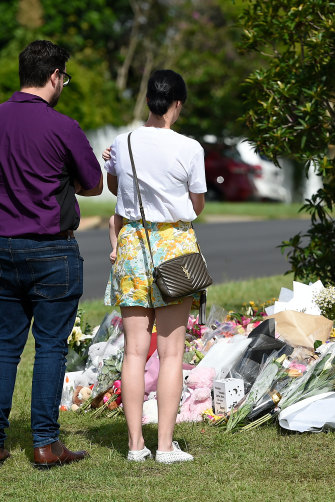 Mourners continued to pay their respects at the scene of the murder at Camp Hill on Friday.