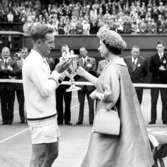 The Queen presents Laver with the men's singles trophy after his 1962 Wimbledon triumph.