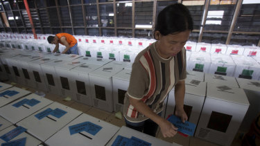 Workers prepare ballot boxes for distribution ahead of April 17 elections in Medan, North Sumatra, Indonesia.
