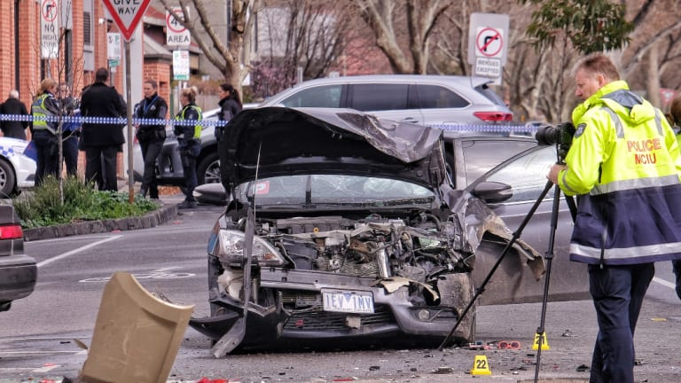 Police at the scene of the brawl and car accident in Collingwood.