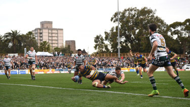 Tolu Latu scores a try for Sydney University on Saturday at North Sydney Oval.