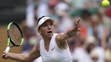 Simona Halep in action against Ukraine's Elina Svitolina during their Wimbledon singles semi-final.
