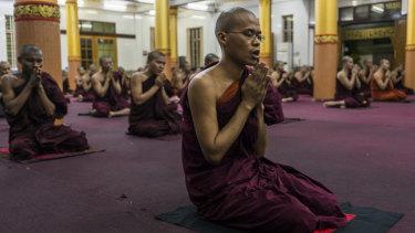 Monks pray in the Bengala monastery in Yangon, Myanmar.