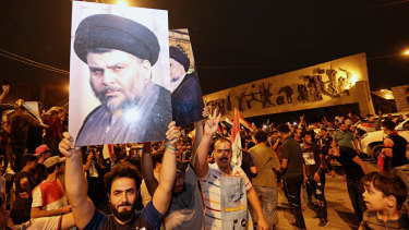 Followers of Shiite cleric Muqtada al-Sadr celebrate in Tahrir Square in Baghdad early on Monday, May 14.