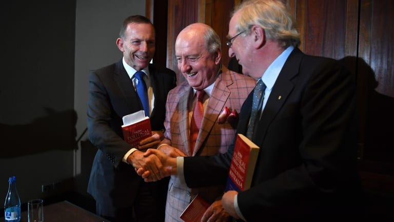 Former prime minister Tony Abbott, left,  shakes hands with Kevin Donnelly, right, as radio host Alan Jones looks on..