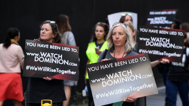 Animal rights protesters took to the streets of Sydney, carrying placards directing people to watch Dominion.