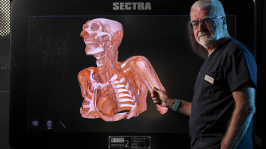 A slice of life - Professor McMenamin at Monash University's new anatomy laboratory.