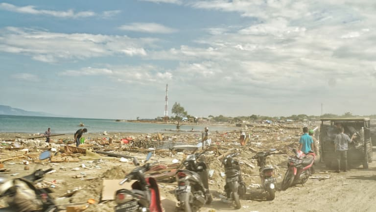 Motorbikes that ran out of fuel are left at the beachfront.