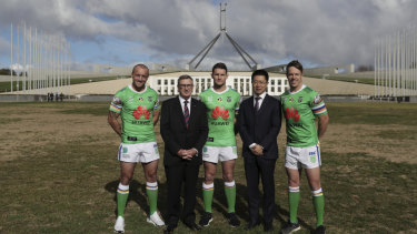 Huawei Australia chairman John Lord and chief executive Hudson Liu with Canberra Raiders players.
