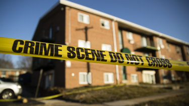 Crime scene tape surrounds the Robert Morris Apartments in Morrisville.