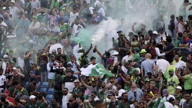 Pakistan fans celebrate their win.