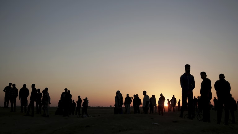 The sun sets over Palestinian protesters gathered at the Gaza Strip border with Israel.