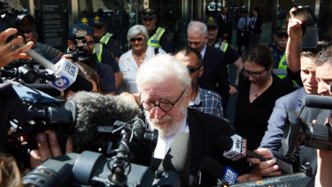 George Pell's barrister Robert Richter, QC, is surrounded by the media as he leaves court on Wednesday.