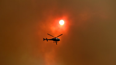 A total fire ban is in place in Sydney and across the state for Friday, with the death toll climbing to four.