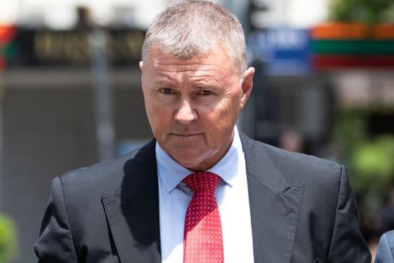 Former CFMEU boss David Hanna (centre) leaving the Brisbane Magistrates Court on Thursday.