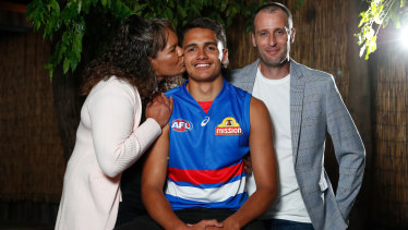 Jamarra Ugle-Hagan poses for a photograph with parents Alice and Aaron.
