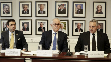 Justin Bassi (left) with former prime minister Malcolm Turnbull and Australian ambassador to the US Joe Hockey.