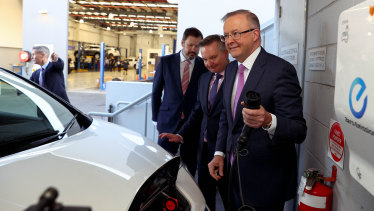Labor leader Anthony Albanese, climate change and energy spokesman Chris Bowen and  industry and innovation spokesman Ed Husic launching the party's electric vehicle policy.
