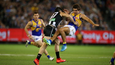 Andrew Gaff feels the full force of a Brayden Maynard tackle in his return to football last Saturday night.