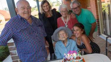 Daphne Keith with her nephew Mick Chapman (left) and her family, celebrating her 108th birthday.