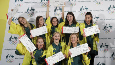 The Australian artistic swimming team with their tickets to Tokyo on Wednesday.