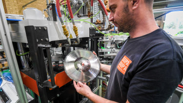 Record press operator and technician Luke Marinovich fitting the stamper to the press.