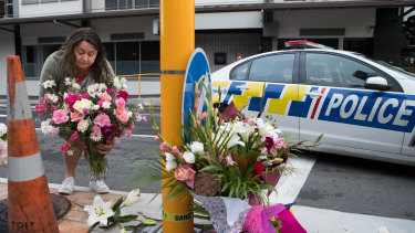 Locals gather to lay flowers near Masjid Al Noor Mosque in Christchurch after a terror attack by a gunman killed 49 people.