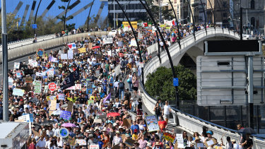 Organisers estimated more than 30,000 people marched across Victoria Bridge from Brisbane's CBD to South Brisbane.