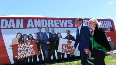 Victorian Premier Daniel Andrews (left) and his wife Catherine board the big red Labor bus.