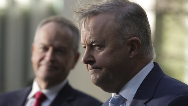 Opposition Leader Anthony Albanese (right) speaks in June with the man he replaced as Labor leader, Bill Shorten.