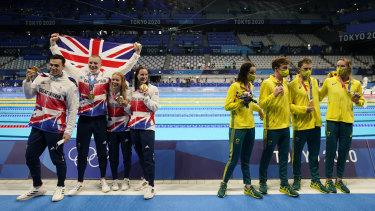 Britain (Kathleen Dawson, Adam Peaty, James Guy and Anna Hopkin) pose after winning gold. Australia (Kaylee McKeown, Zac Stubblety-Cook, Matthew Temple and Emma McKeon), right, won bronze.