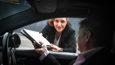 Lawyer Kathy Wilson has been witnessing wills for her clients through car windows.