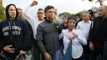 Leopoldo Lopez, centre, is seen surrounded by supporters outside La Carlota air base in Caracas.