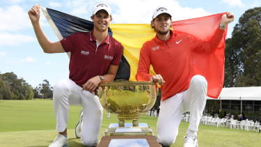 Flying the flag: Belgium's Thomas Detry, left,, and Thomas Pieters pose with the winning trophy after taking out the World Cup of Golf.