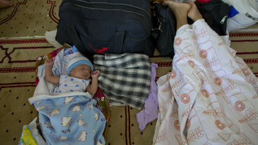 Ten-day-old Amdad Ahamed sleeps at a community centre, where his family has taken refuge in for fear of retaliation towards their community after the Easter Sunday bombings, in Pasyala, north east of Colombo, Sri Lanka.